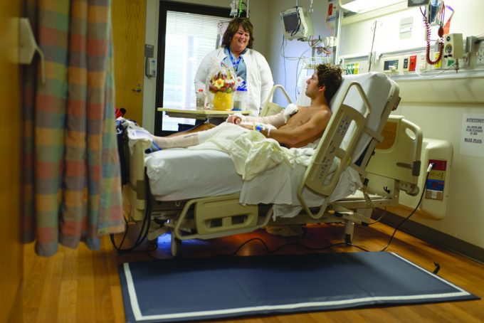 Rhonda Osteen, R.N.-BC, B.S.N., and a patient
